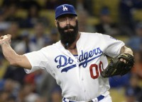 Reports: Dodgers' Wilson to exercise option
