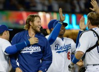 Dodgers claim NL West title in 9-1 win over Giants