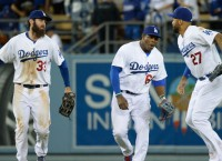 L.A clinches tie for NL West with win over Giants