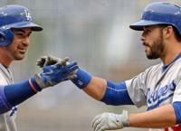 Dodgers flex muscle, swat Padres