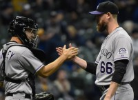 Rockies' Axford takes leave to be with ailing son
