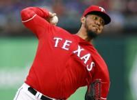 Rangers beat Astros behind Gallardo, Beltre