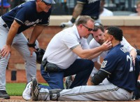 Brewers' Gomez OK after getting beaned