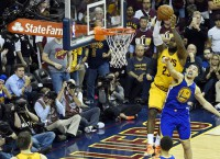 James, Cavs hold on to take Game 3